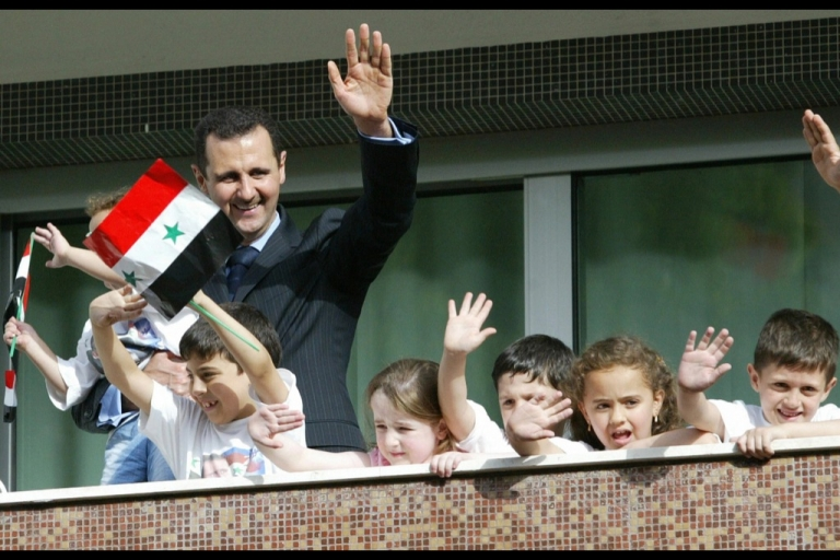 <p>Children join Syrian President Bashar al-Assad as he waves to his supporters in Damascus.</p>