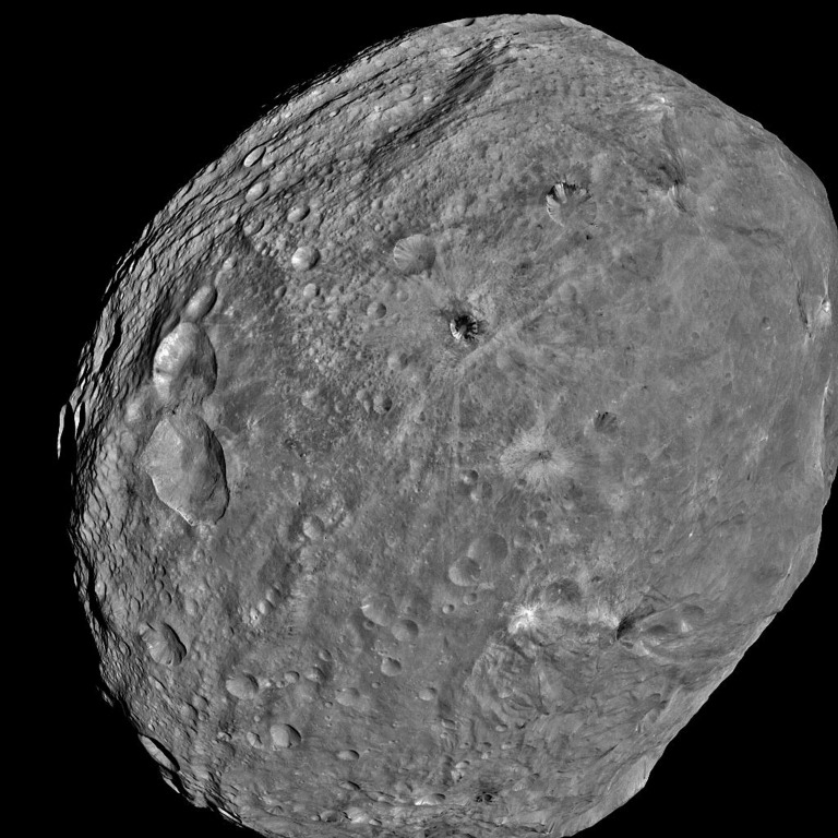 <p>The giant asteroid Vesta is seen in an image taken from the NASA Dawn spacecraft about 3,200 miles above the surface on July 24, 2011.</p>