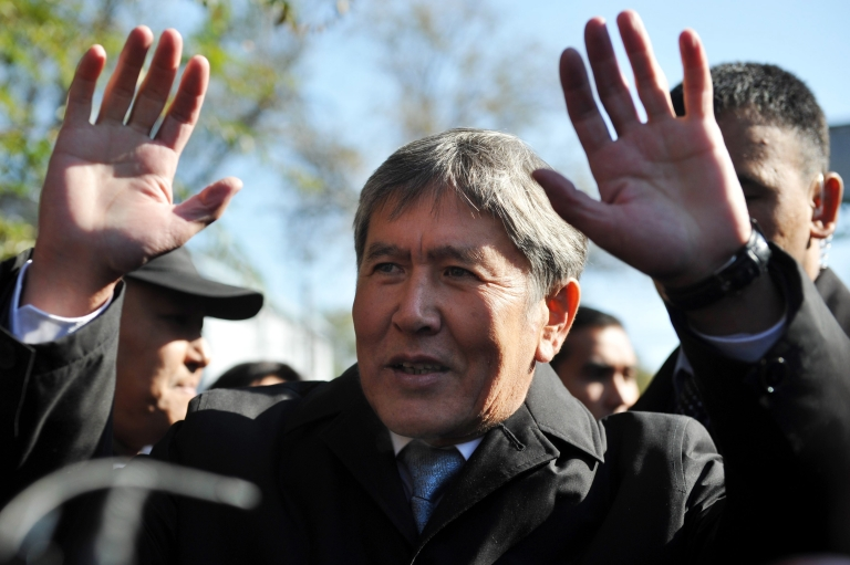 <p>Almazbek Atambayev speaks with journalists outside a polling station in Kyrgyzstan's capital Bishkek on Oct. 30, 2011.</p>