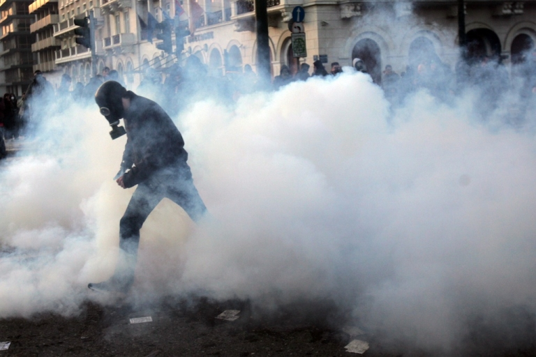 <p>People clash with police in the streets during a demonstration against the new austerity measures on February 12, 2012 in Athens, Greece. Austerity has not saved Greece's economy, but it may fare better in other countries</p>