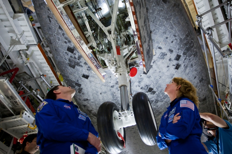<p>NASA is seeking commercial tenants to rent parts of the historic Kennedy Space Center. Here, NASA astronauts Rex Walheim and Sandy Magnus inspect the front landing gear of the orbiter Atlantis on April 7, 2011.</p>