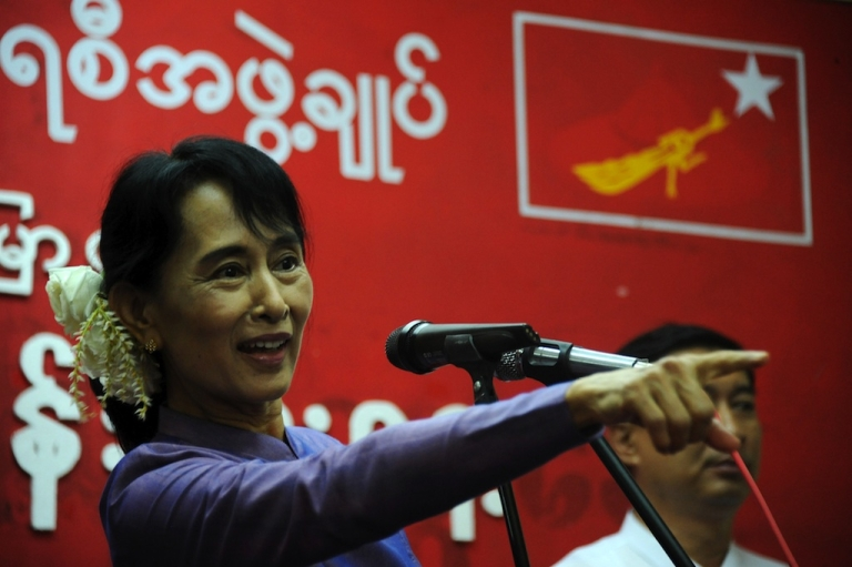 <p>Burmese democracy icon Aung San Suu Kyi delivers a speech during a ceremony to mark her father General Aung San's 96th birth anniversary at the National League for Democracy (NLD) headquarters in Rangoon, Burma, on February 13, 2011.</p>