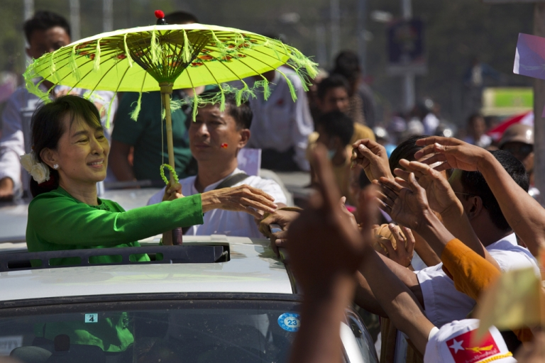 <p>PATHEIN, MYANMAR - FEBRUARY 7: Myanmar opposition leader Aung San Suu Kyi greets the crowds from the top of a vehicle during campaigning in the Delta region on her second campaign trip on February 7, 2012 in Pathein, Myanmar.  Aung San Suu Kyi is beginning her election campaign as an official candidate ahead of the April 1 by-elections. This was the first time in twenty years that Suu Kyi has visited the Delta region. (Photo by Paula Bronstein/Getty Images)</p>