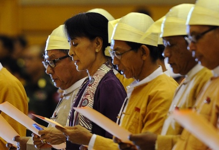 <p>Myanmar opposition leader Aung San Suu Kyi (2nd L) along with other elected members of parliament read a parliamentary oath during a session in Naypyidaw, Myanmar on May 2, 2012.</p>