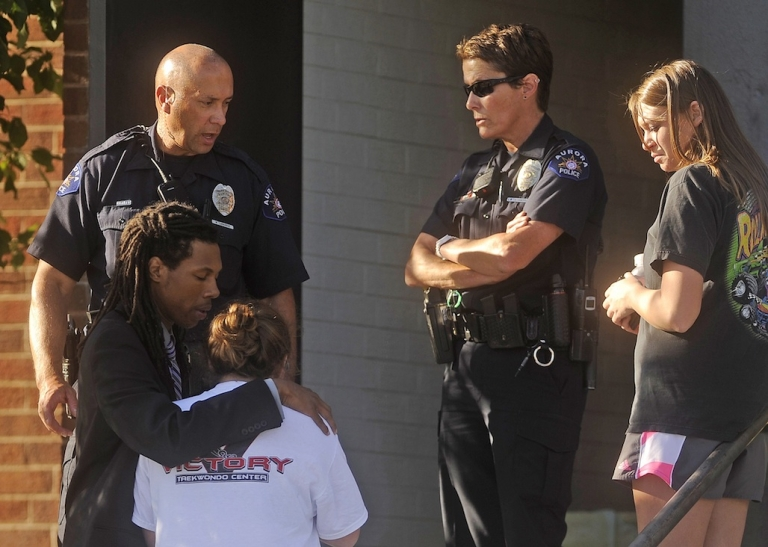 <p>People react outside Gateway High School a few blocks from the scene of the Century 16 Theatre shootings in Aurora, Colorado July 20, 2012.</p>
