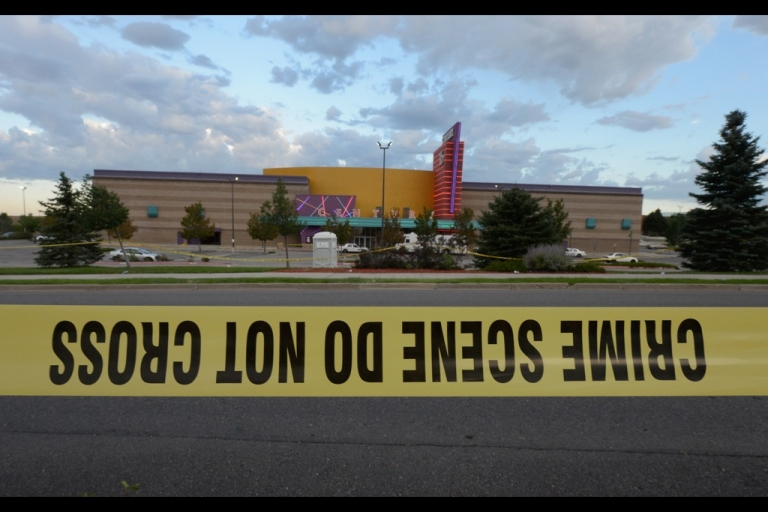 <p>AURORA, CO - JULY 23:  Crime scene tape surrounds the Century 16 movie theater where 12 people were killed in a shooting rampage last Friday, on July 23, 2012 in Aurora, Colorado.  Suspect James Holmes, 24, allegedly went on a shooting spree and killed 12 people and injured 58 during an early morning screening of 'The Dark Knight Rises.'  (Photo by Kevork Djansezian/Getty Images)</p>