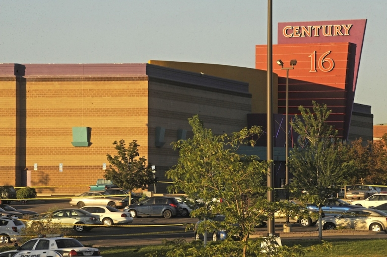 <p>The Century 16 Theatre where a masked gunman killed 14 people at a midnight showing of the new Batman movie in Aurora, Colorado July 20, 2012. A masked gunman killed 14 people at a midnight showing of the new Batman movie in a suburb of Denver early on Friday, sparking pandemonium when he hurled a teargas canister into the auditorium and opened fire on moviegoers.</p>