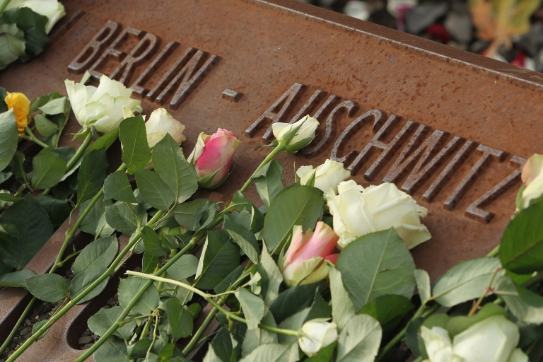 <p>White roses left by mourners lie next to one of the many plaques detailing transports of Berlin Jews to concentration camps at the Gleis 17 (Track 17) memorial on the 70th anniversary of the deportations on Oct 18 in Berlin.</p>