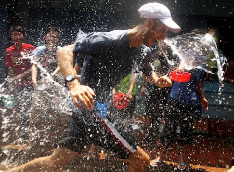 <p>Lao people splash water on tourists during Songkran festivities on April 13, 2008, in Luang Prabang, Laos.</p>