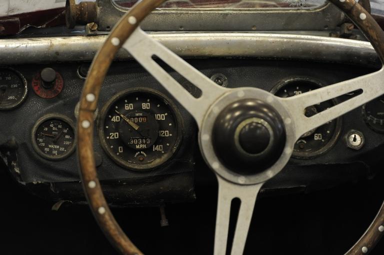 <p>A steering wheel of an Austin Healey.</p>