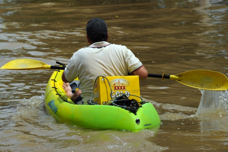 <p>A resident of Rockhampton, Queensland, paddles a kayak loaded with XXXX beer back to his home during the epic Australian floods of January, 2011, when floodwaters covered an area bigger than France and Germany combined and closed major transport links.</p>
