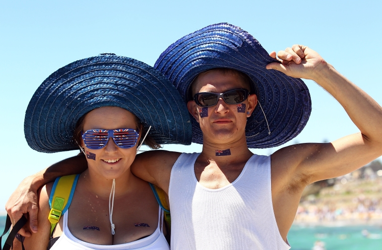 <p>Beachgoers pose as Australia celebrates Australia Day at Cottesloe Beach on January 26, 2011 in Perth, Australia. Australia Day commemorates the arrival of the First Fleet to Sydney in 1788.</p>