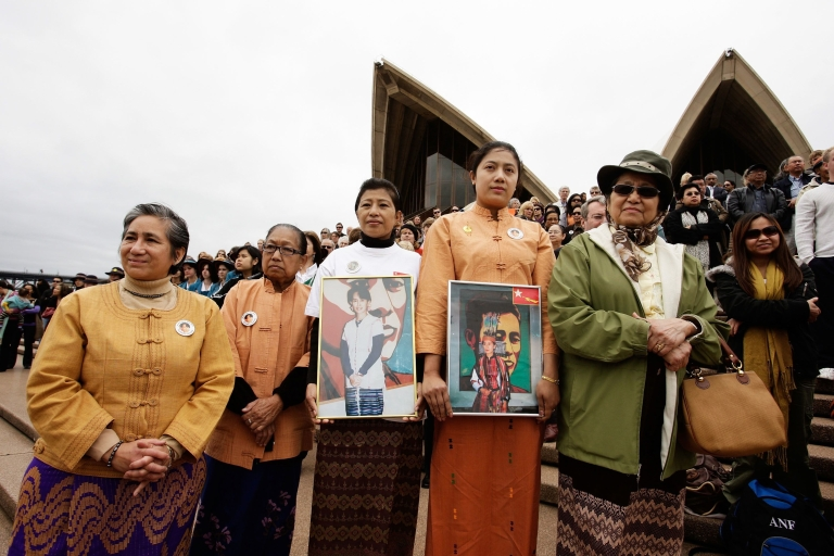 <p>Australian women, including the Prime Minster's wife Therese Rein, gathered to show support for the freedom of Burmese democracy figure Aung San Suu Kyi at the Sydney Opera House in Sydney, Australia in 2009. Suu Kyi was elected prime minister of Myanmar, as leader of the winning National League for Democracy party, in the 1990 elections, but was subsequently detained by the military junta, preventing her from assuming office.</p>