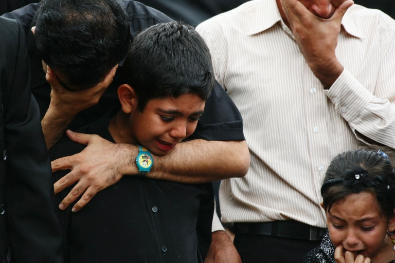 <p>Relatives of some of the 30 killed when a boat full of asylum seekers crashed on the rocks at Christmas Island on Dec. 15, 2010, trying to reach Australian soil, grieve during Muslim and Christian services held Feb. 15, 2011 in Sydney, Australia.</p>