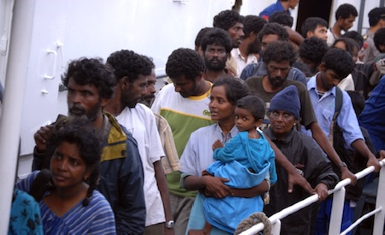 <p>A group of 87 asylum seekers from Sri Lanka are rescued by Indonesian Maritime Police in Panaitan island where they were stranded after they ran out of fuel, food and water. The refugees left Sri Lanka on August 2010 in an attempt to reach Australia's remote Christmas island.</p>