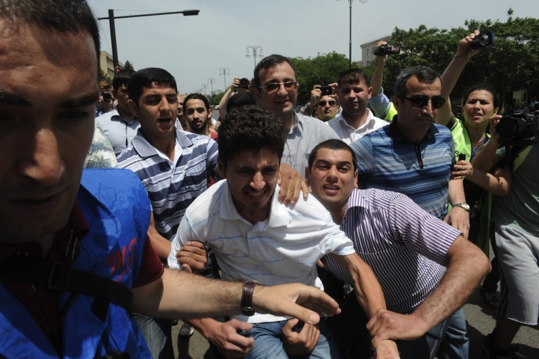 <p>Plainclothes police officers detain opposition activists who tried to hold a rally near public television station which is the Azerbaijani partner for Eurovision broadcasts in Baku, on May 23, 2012.</p>
