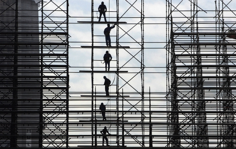 <p>Construction in Dubai. As the Arab world expands politically; so too, does its banking and economic institutions. Here, Asian laborers work on a construction project in Dubai.</p>