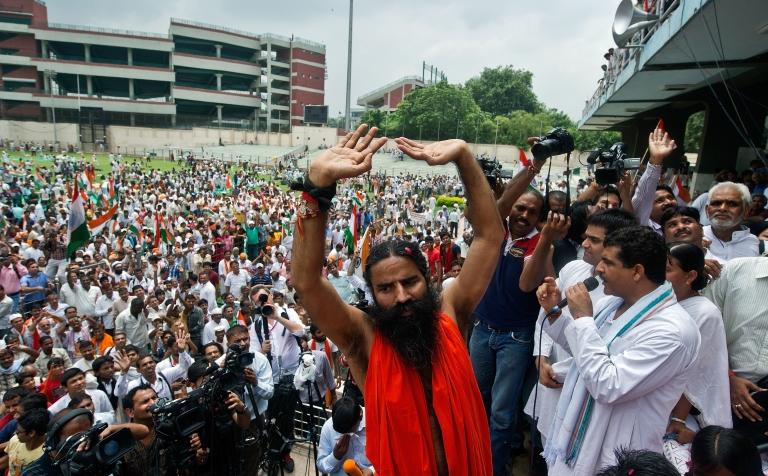 <p>Indian yoga guru Baba Ramdev gestures after breaking his fast at Ambedkar stadium in New Delhi on August 14, 2012.</p>