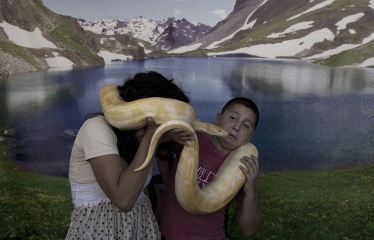 <p>Arab Israeli children pose with a pet snake at an amusement park in the northern Israeli city of Acre on August 31, 2011, as Muslims celebrated the Eid al-Fitr holiday which marks the end of the holy fasting month of Ramadan.</p>