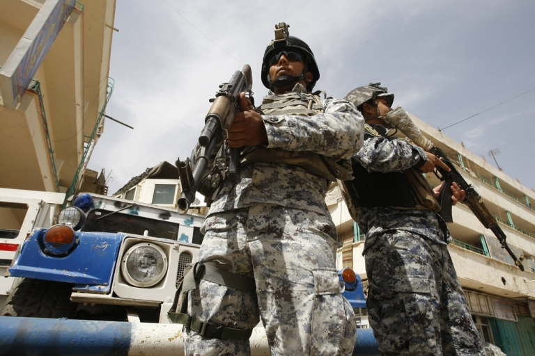 <p>Hightened security is seen on the streets of the Iraqi capital Baghdad on May 8, 2011, after the accused mastermind of last year's Baghdad church siege overpowered a policeman while being led to questioning, sparking a jail mutiny that killed six police, including a general, and 11 inmates.</p>