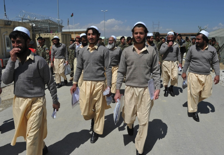 <p>Newly-freed Afghan prisoners walks after a ceremony handing over the Bagram prison to Afghan authorities, at the US airbase in Bagram north of Kabul on September 10, 2012. The US on September 10 formally handed control to Afghanistan of more than 3,000 detainees at a controversial prison dubbed the country's 'Guantanamo Bay', but disagreements remain over the fate of hundreds of inmates. Kabul has hailed the transfer of Bagram prison as a victory for sovereignty as NATO prepares to hand over full national security to Afghans and withdraw its combat troops by the end of 2014.</p>