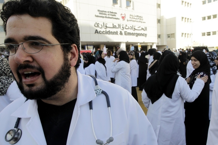 <p>Doctors and nurses gather outside Salmaniya medical complex before marching towards Pearl Square in the Bahraini capital Manama on February 20, 2011 to demand the resignation of Education Minister Majed bin Ali al-Nuaimi and Health Minister Faisal al-Hamr in anti-government protests in the tiny Gulf kingdom.</p>