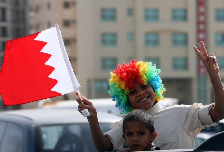 <p>A young Bahraini pro-government supporter waves his national flag during a gathering near the Al-Fateh mosque following Friday's noon prayers in the capital Manama on February 18, 2011 as angry Shiites burried the dead of a violent police raid on anti-regime protesters.</p>