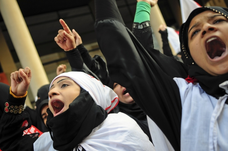<p>Anti-government protesters gather outside the Saudi Arabian embassy in Manama, Bahrain on March 15, 2011, as Bahrain's king Hamad declared a three-month state of emergency.</p>