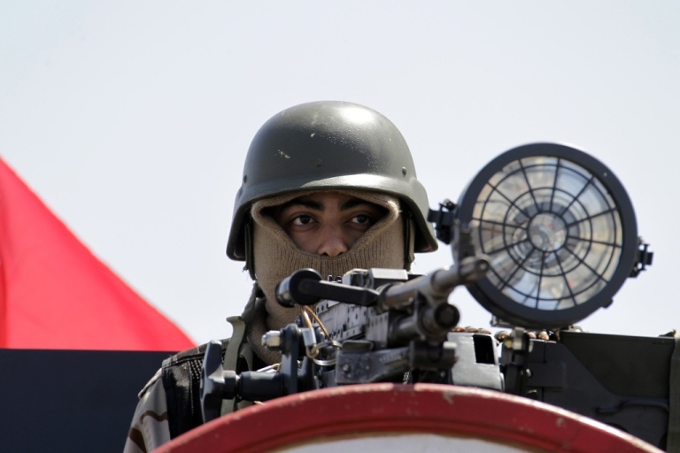 <p>A member of Bahrain's armed forces secures Manama's Pearl Square on March 19, 2011.</p>
