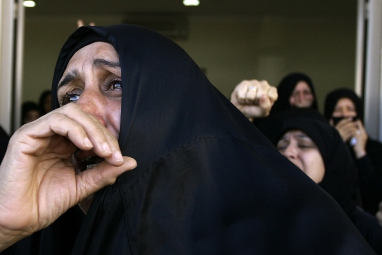 <p>Bahraini Shiite women cry during a funeral for protester killed by government security forces in central Manama on March 22, 2011.</p>
