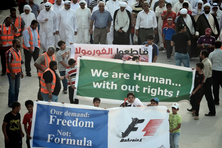 <p>Bahraini Shiite Muslims holding up banners in an April 17 demonstration calling for cancellation of the upcoming Bahrain F1 Grand Prix.</p>