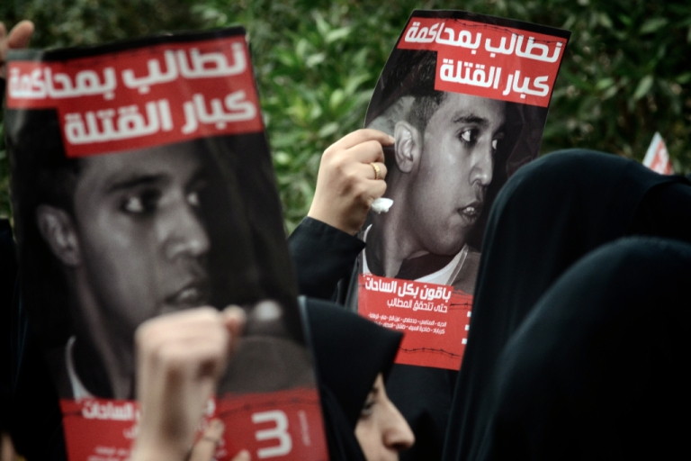<p>Bahraini women hold posters of Ali Mushaima who was killed last year during the deadly crackdown on street protests, during a rally calling for political reforms in the Shiite village of Jidhafs, West Manama, on March 23, 2012. Thousands of Bahrainis took to the streets of Shiite villages around the capital to demand reforms, with some calling for the ouster of the Sunni-ruled regime.</p>