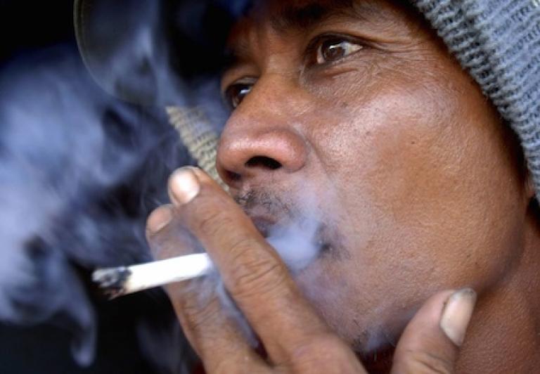 <p>A fisherman smoking on the resort island of Bali on May 30, 2008.</p>