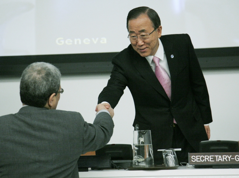 <p>Ban Ki-moon, right, greets a delegate before the start of a UN General Assembly meeting on Thursday where a briefing was to take place on the situation in Syria.</p>
