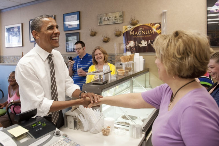 <p>US President Barack Obama greets employees as he orders ice cream during a surprise stop at Deb's Ice Cream and Deli in Cedar Rapids, Iowa, on July 10, 2012.</p>