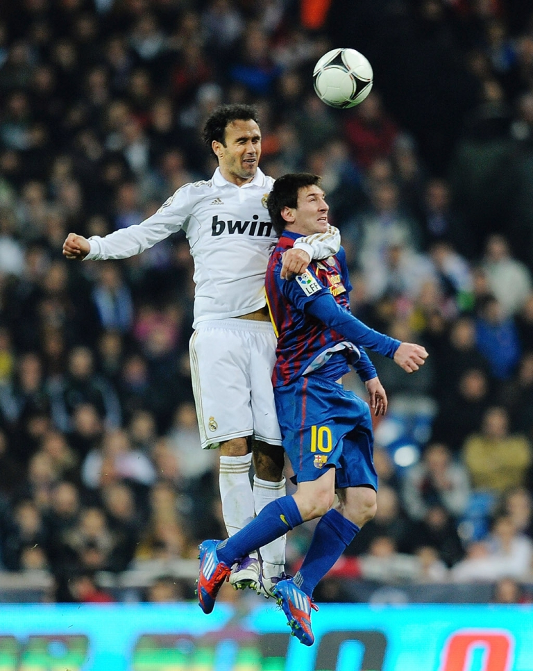 <p>MADRID, SPAIN - JANUARY 18: Fernando Carvalho (L) of Real Madrid tackles Lionel Messi of Barcelona during the Copa del Rey Quarter Finals match between Real Madrid and Barcelona at Estadio Santiago Bernabeu on January 18, 2012 in Madrid, Spain.  (Photo by Denis Doyle/Getty Images)</p>