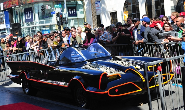 <p>A crowd gathers around the Batmobile, cordoned off ahead of a ceremony for Adam West, who played Batman in the original TV series, for the unveiling of his star on Hollywood's Walk of Fame on April 5, 2012 in Hollywood, California.</p>