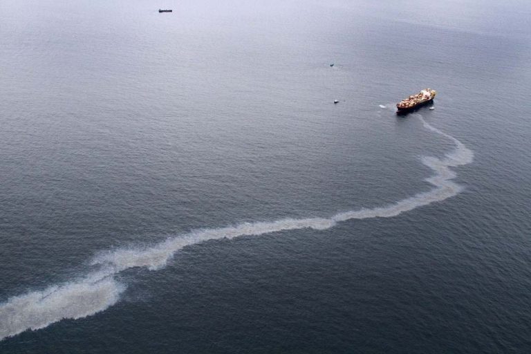 <p>An oil slick is seen coming from the grounded vessel Rena, on October 9, 2011 in Tauranga, New Zealand.</p>