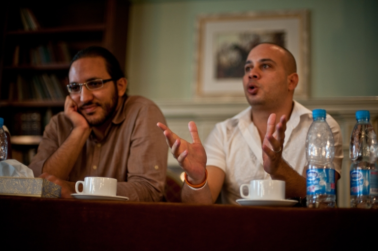 <p>Ramy Raoof (L) and Ahmed Maher (R) speak at the Open Hands Initiative / GlobalPost  'Covering a Revolution' seminar in Cairo, October 2011.</p>