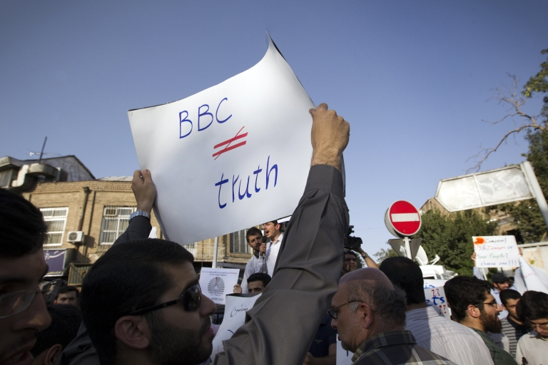 <p>An Iranian hardline student holds a sign opposed to the BBC during a demonstration in August outside the British Embassy in Tehran to protest against what students called the 'savage' crackdown by British police on rioters in London.</p>