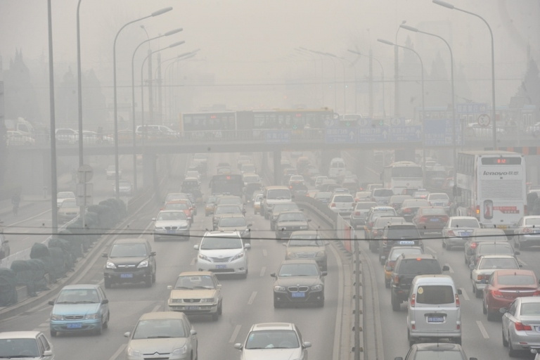 <p>Vehicles make their way along a road on a smoggy day in Beijing. Beijing's government bowed to a vocal online campaign for a change in the way air quality is measured in the Chinese capital, one of the world's most polluted cities.</p>