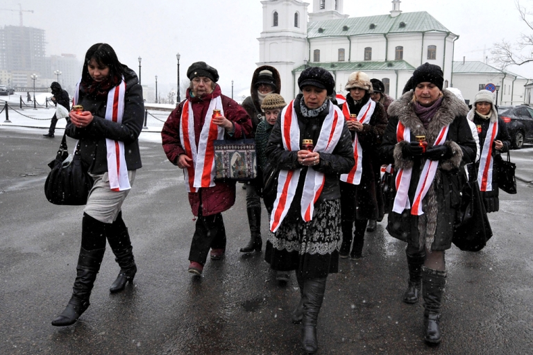<p>Belarus opposition supporters mark the three-month anniversary of the Belarus presidential election in Minsk on March 19, 2011.</p>
