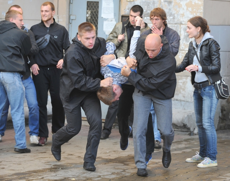 <p>Plain clothed Belarusian policemen detain activists during an Independence Day celebration in Minsk on July 3, 2011.</p>