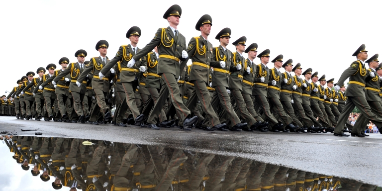 <p>Belarusian solders march in Minsk. Ecuador has turned down Belarus' request to extradite a former police detective who claims he had to flee Belarus after uncovering high-level corruption.</p>