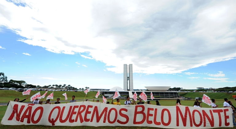 <p>Activists hold a banner which reads