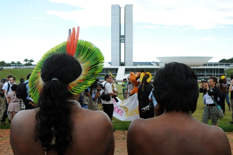 <p>A Brazilian indigenous chief attends a February protest in Brasilia against the construction of the Belo Monte hydroelectric dam.</p>