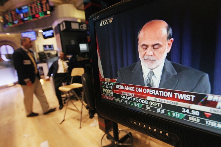 <p>Wall Street traders gather near a TV playing Fed Chairman Ben Bernanke's news conference on November 2, 2011 in New York City.</p>