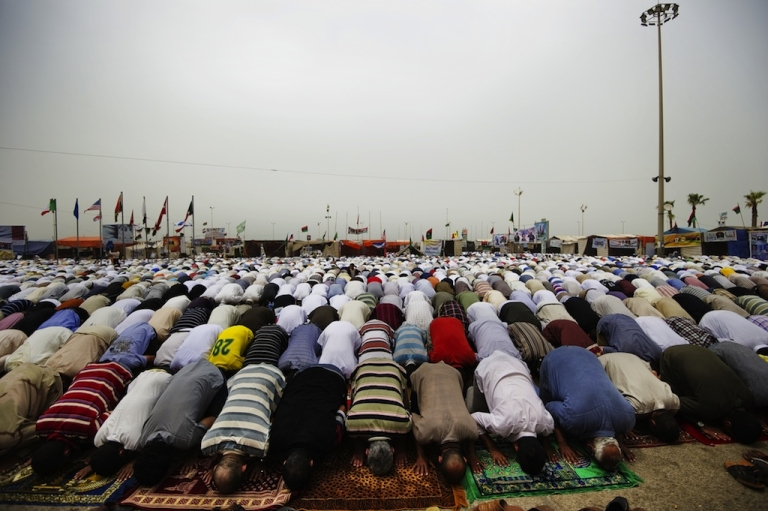 <p>Thousands of Libyans attend Friday prayer in Revolution Square in Benghazi on June 3, 2011.</p>