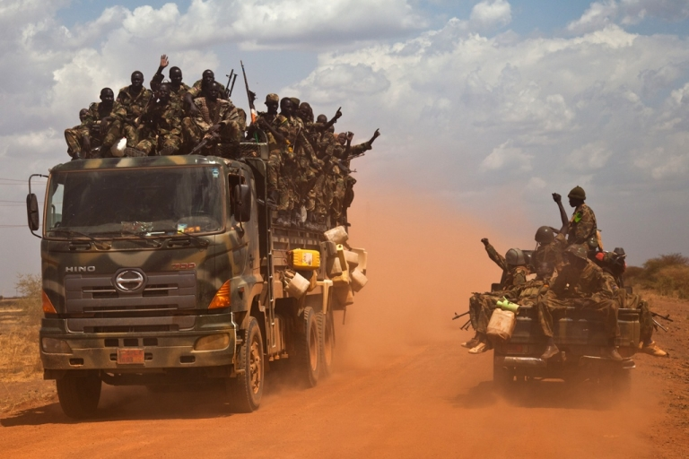 <p>Vehicles of the SPLA (South Sudan People's Liberation Army) on the road from Bentiu to Heglig, on April 17, 2012. The SPLA (South Sudan People's Liberation Army) has seized both the town and oilfields of Heglig but Sudan vows to retake the area. War threatens between the two countries.</p>
