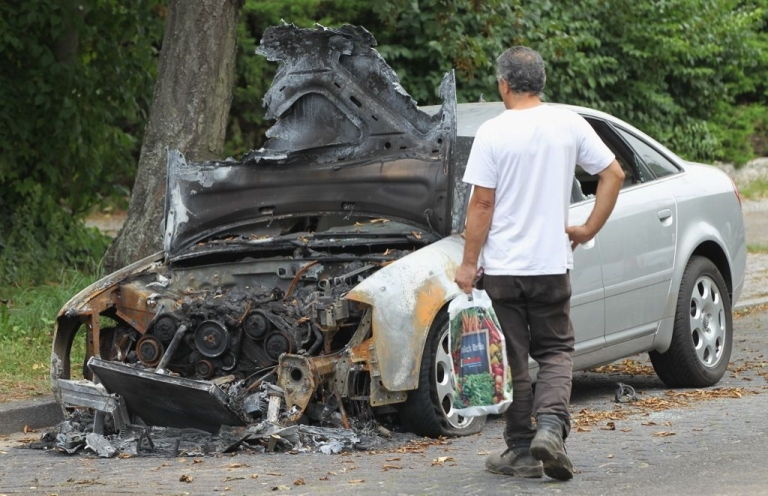<p>One of hundreds of cars set ablaze during a series of car arsonies in Berlin, Germany in August 2011.</p>